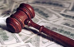 Private Investigator Phoenix wood gavel atop money
